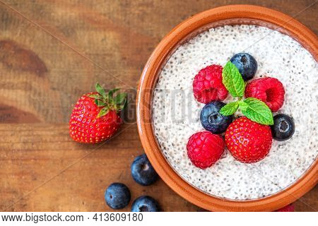 Chia Seed Pudding Made With Fresh Berries On Wooden Table.  Chia Seeds Yogurt.
