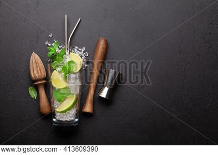 Mojito cocktail making. Ingredients and drink utensils. Top view flat lay with space for your recipe