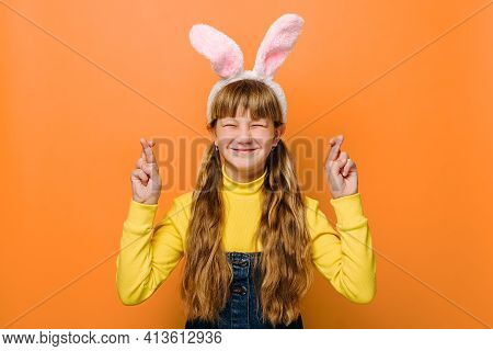 Close Up Head Shot Portrait With Happy And Wishing Little Schoolgirl In Bunny Fluffy Ears. Cute Teen