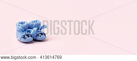 Cute Blue Newborn Baby Boy Shoes With Funny Bunny Rabbit Decoration Over Pink Background. Baby Showe