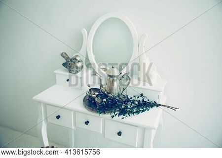 Olive Branch And Silver Service In A Stylish Boudoir.