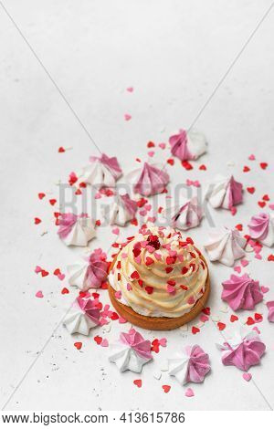 Mothers Day Holiday Brunch With Cupcake Craem And Pink Flowers On White Background