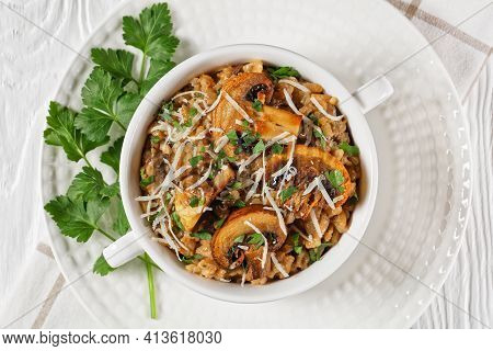 Classic Creamy Mushroom Risotto Sprinkled With Grated Parmesan Cheese And Parsley In A White Bowl, C