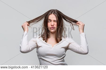 Frustrated Woman Having A Bad Hair. Woman Having A Bad Hair, Her Hair Is Messy And Tangled. Messy Ha