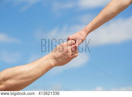 Lending A Helping Hand. Hands Of Man And Woman Reaching To Each Other, Support. Solidarity, Compassi