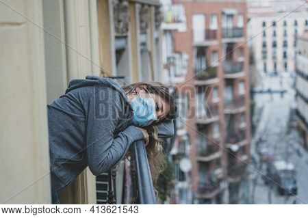 Beautiful Depressed Lonely Woman With Face Mask In Quarantine Staring Out On Balcony Feeling Sad, Lo