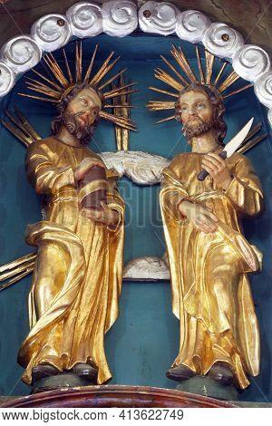 SVETI PETAR MREZNICKI, CROATIA - JULY 14, 2013: St. Cosmas and Damian, statue on the high altar in the parish church of St. Peter in Sveti Petar Mreznicki, Croatia
