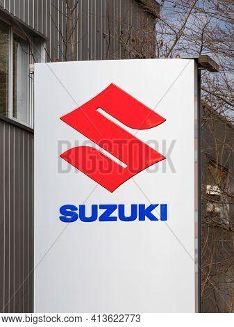 Hamburg, Germany – March 17, 2021. Signage on pole identifying Suzuki car or motorcycle dealership.