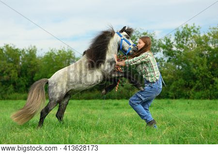 Aggressive Animal Is Attacking And Biting Young Woman In Her Neck In Outdoors, Side View. Caucasian