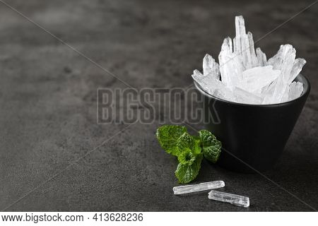 Menthol Crystals And Mint Leaves On Grey Background. Space For Text