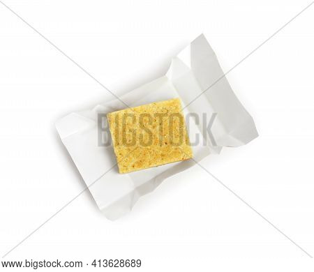 Unwrapped Bouillon Cube On White Background, Top View