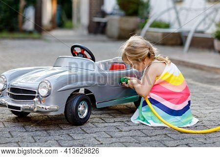 Little Toddler Girl Playing With Big Vintage Toy Car And Having Fun Outdoors In Summer. Cute Child R