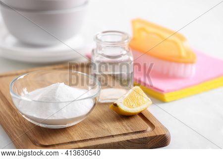 Baking Soda, Lemon And Vinegar On White Table. Eco Friendly Detergents