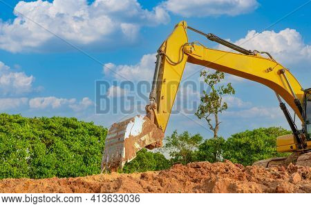 Backhoe Working By Digging Soil At Construction Site. Bucket Of Backhoe Are Digging Soil. Crawler Ex