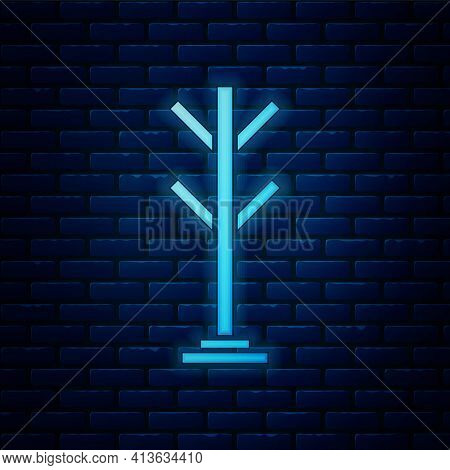 Glowing Neon Coat Stand Icon Isolated On Brick Wall Background. Vector