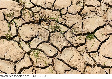 Global Warming Concept, Cracked Soil Arid Land With Dry And Cracked Ground Desert Texture Background