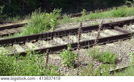 Railway Tracks On Concrete And Wood Sleepers. Jointed Track Made With Fishplates On 4-bolts. Metal R