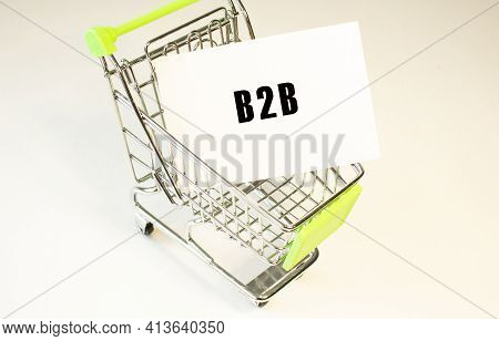 Shopping Cart And Text B2b On White Paper. Shopping List Concept On Light Background.