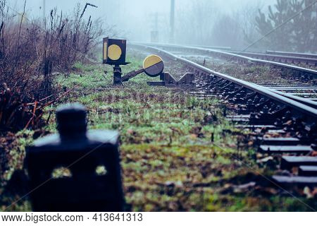 Railroad Track Switches At Railway Junction In Front Defocused Derailer Lantern