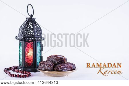 Ramadan Food And Drinks Concept. Ramadan Arabian Lamp, Wood Rosary, And Dates Fruit On White Backgro
