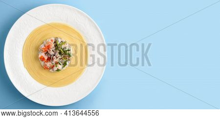 Linguini Pasta With A Seafood Cocktail In A Creamy Sauce Laid Out In Circles On A White Plate On A L