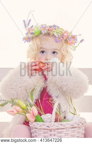 easter egg hunt girl with flowers and eggs