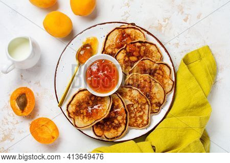 Homemade Pancakes With Fresh Apricot Fruit And Jam On A Light Slate, Stone Or Concrete Background. T