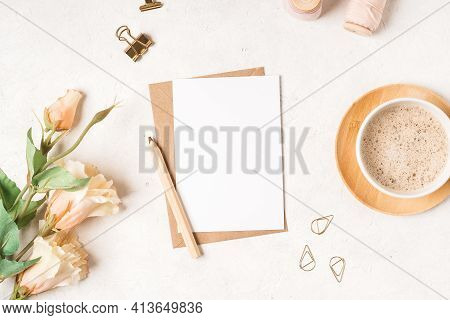 Craft Paper Envelope With White Blank Paper Note Mockup With Pencil, Flowers, Cup Of Coffee, Tag, Tw