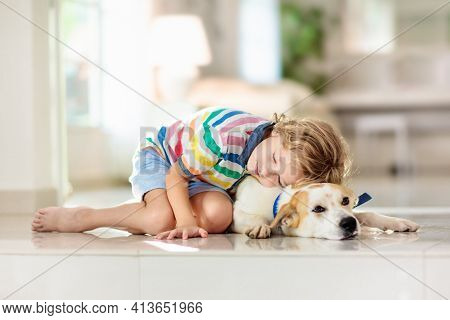 Child Playing With Dog. Kids Play With Puppy.
