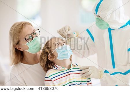 Coronavirus Nasal Swab Test For Kids. Doctor Taking Saliva Sample For Covid-19 Diagnostics Of Child.