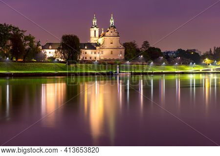 Basilica Of St Michael The Archangel With Reflection In The River At Night, Krakow, Poland