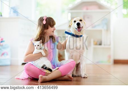 Child Playing With Cat And Dog. Kids Play With Puppy And Kitten. Little Girl And Large Dog At Home.