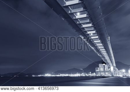 Cutterstone Bridge And Cargo Port In Hong Kong City At Night