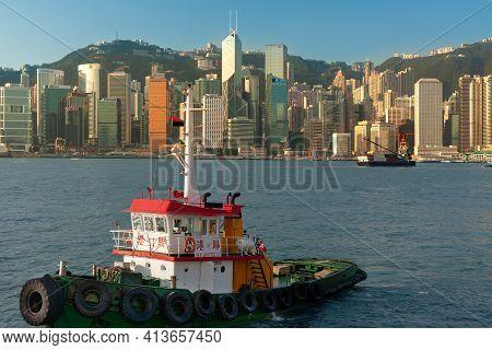 Hong Kong Island, Hong Kong, China, Asia - November 12, 2008:  Tugboat In Front Of The Modern Skylin
