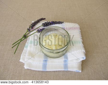 Homemade Deodorant With Essential Lavender Oil In A Glass Jar