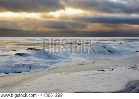 Morning Or Evening Landscape Of A Large Icy Lake And Cloudy Sky For A Natural Background With A Hori