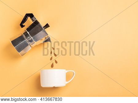 Paper Cut Drops Pouring From A Geyser Coffee Maker Into A Cup On Yellow Paper Background. Coffee Pre