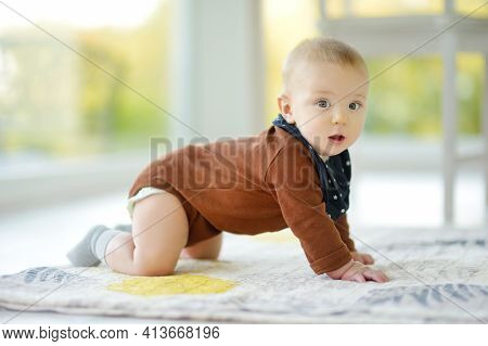 Cute Five Months Old Baby Boy Rocking Back And Forth On Hands And Knees. Baby During Floortime. Ador