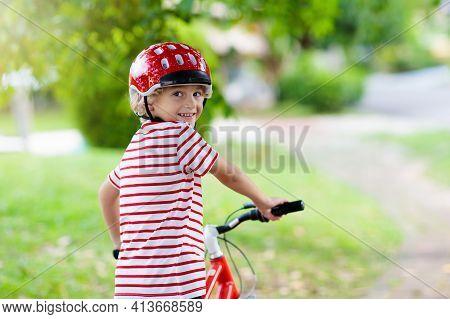 Kids On Bike In Park. Children Going To School Wearing Safe Bicycle Helmets. Little Boy Biking On Su
