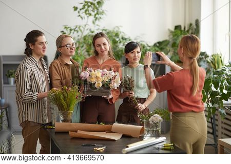 Diverse Group Of Young Florists Florist Holding Floral Composition While Posing For Photo In Flower