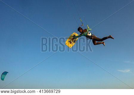 Kitesurfing on the waves of the Red sea, Egipt. Kitesurfing, Kiteboarding action photos Kitesurfer In action