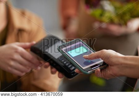 Close Up Of Unrecognizable Young Woman Paying Via Nfc In Flower Shop And Buying Bouquet , Copy Space