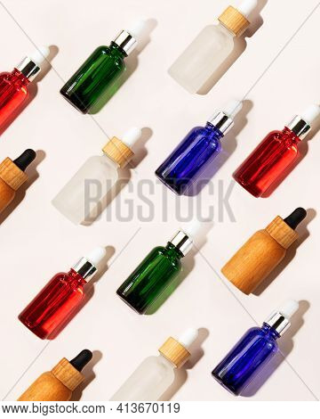 Pattern From The Multicolored Cosmetic Bottles With Dropper.glass And Wooden Packaging.concept Of Th