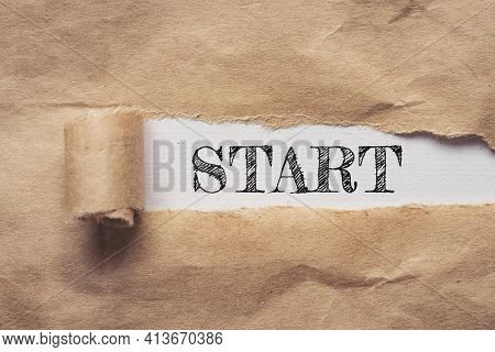 Business And Finance. Torn Brown Paper On A White Background, The Text - Start