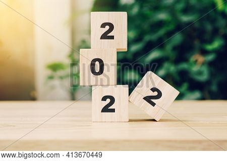 2022 Happy New Year On Wood Block On Wood Table With Sunlight. New Year Concept.