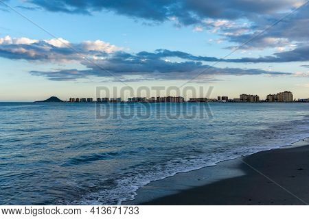 The Seashore Of La Manga Del Mar Menor With Ist Many Hotels And Beaches At Sunset Under An Expressiv