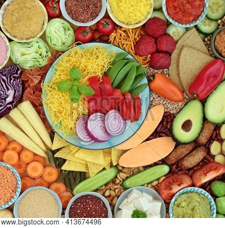 Vegan health food selection for immune defense high in antioxidants, protein, omega 3, anthocyanins, smart carb, lycopene, vitamins and minerals. Food for a healthy immune system concept. Top view.