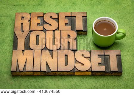 reset your mindset advice - word abstract in vintage letterpress wood type with coffee, self improvement and personal development concept