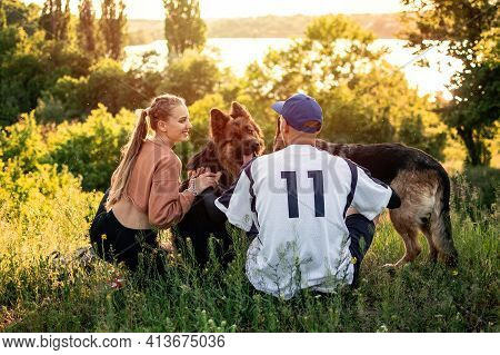Active Family, Fitness Couple, Pet Love, Dog Training, Best Dog Breeds For Family. Young Sports Coup