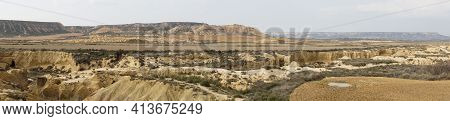 A Panorama View Of The Desert Grasslands And Mesas And Table Mountains In The Bardenas Reales Desert